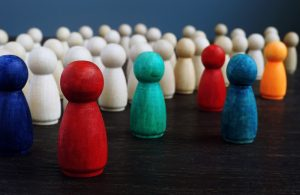 Wooden figures representing racial diversity