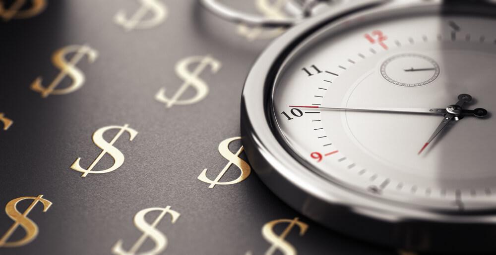 Ticking clock against money background