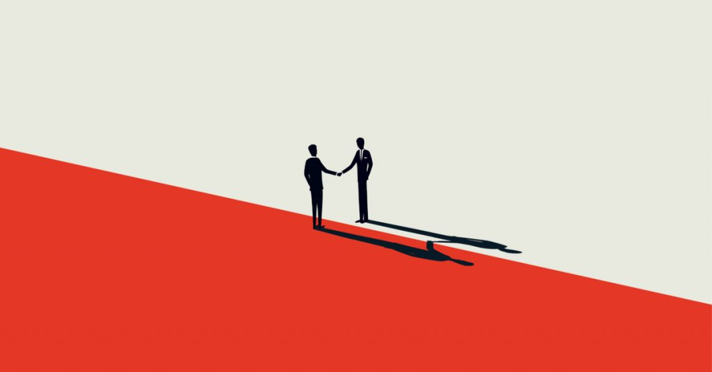 Graphic representation of M&A two men shake hands on border